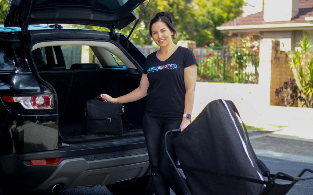 mobile-beauty-therapist-arrives-at-customers-home-and-retrieves-beauty-supplies-from-boot-of-car
